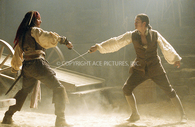 JOHNNY DEPP and ORLANDO BLOOM on the set of 'Pirates of the Caribbean: The Curse of the Black Pearl.' Ref: TVSL0001. No reproduction rights granted or implied. All rights reserved by copyright holders. Supplied by NY Photo Press.   ....NY Photo Press:  ..phone (646) 267-6913;   ..e-mail: info@nyphotopress.com