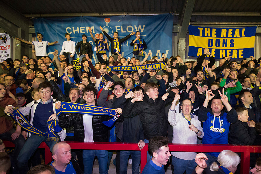 AFC Wimbledon fans celebrate their sides victory at full time  <br /> <br /> <br /> Photographer Craig Mercer/CameraSport<br /> <br /> The EFL Sky Bet League One - AFC Wimbledon v Milton Keynes Dons - Tuesday 14th March 2017 - The Cherry Red Records Stadium - London<br /> <br /> World Copyright &copy; 2017 CameraSport. All rights reserved. 43 Linden Ave. Countesthorpe. Leicester. England. LE8 5PG - Tel: +44 (0) 116 277 4147 - admin@camerasport.com - www.camerasport.com