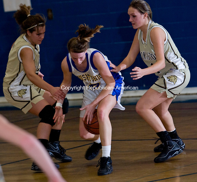 FALLS VILLAGE, CT - 02 FEBRUARY 2009 -020209JT06-<br /> Housatonic's Sarah Godburn loses grip of the ball as she's caught between Thomaston's Morgan Doyle and Brittany Brandt during Monday's game at Housatonic. Housy won.<br /> Josalee Thrift / Republican-American