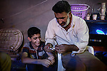 29/08/15. Shaqlawa, Iraq. -- Ali, 50 y.o., also known as Abu Chai (the father of tea) arrived from Falluja in January 2014 and now lives in a room that costs 600.000 IQD per month. Having only one son, Omar - who is 12 y.o. (left)  among his 6 children,  Ali is the only one in the family that works. He sells cups of tea for 500 IQD each at the centre of Shaqlawa.