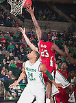 North Texas Mean Green forward Kedrick Hogans (24) and Louisiana Lafayette Ragin Cajuns forward/center Kadeem Coleby (23) in action during the game between the Louisiana Lafayette Ragin Cajuns and the University of North Texas Mean Green at the North Texas Coliseum,the Super Pit, in Denton, Texas. Louisiana Lafayette defeats UNT 57 to 53.