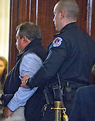 Unidentified man is escorted out of the United States Senate Judiciary Committee confirmation hearing on the nomination of US Senator Jeff Sessions (Republican of Alabama) to be Attorney General of the United States by a US Capitol Police Officer on Capitol Hill in Washington, DC on Tuesday, January 10, 2017.<br /> Credit: Ron Sachs / CNP