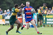 Liam Fizsimons looks to fend off Peni Buakula. Counties Manukau Premier Counties Power Game of the Week Club Rugby Round 4 game between Pukekohe and Ardmore Marist, played at Colin Lawrie Fields Pukekohe on Friday March 30th 2018.<br /> Ardmore Marist won the game 27 - 21 after leading 13 - 11 at halftime.<br /> Pukekohe Mitre 10 Mega 21 -Trent White, Samu Pailegutu tries, Sione Fifita conversion, Sione Fifita 2, Vilitati Sabani penalties. Ardmore Marist South Auckland Motors 27 - Katetistoti Nginingini, Karl Ropati, Alefosio Tapili tries, Latiume Fosita 3 conversions, Latiume Fosita 2 penalties. <br /> Photo by Richard Spranger.