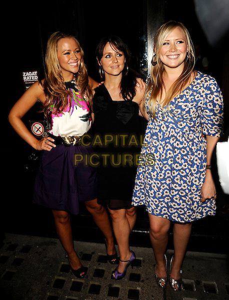 KIMBERLEY WALSH, AMY WLASH & SALLY WALSH.At Sally Walsh's 30th Birthday Party, Burlington Club, London, England, 2nd August 2008..Girls Aloud Kimberly full length purple skirt black waist belt white pink floral print top  black blue sisters family .CAP/CAN.©Can Nguyen/Capital Pictures