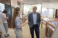 """Physics professor Daniel Snowden-Ifft listens to Jessica Roginsky '16 talk about """"A Powerful Paralytic: Studying Spinal Neuron Responses to a Novel Cone Snail Venom Peptide."""" After researching all summer, Occidental College students present their work at the annual Summer Undergraduate Research Conference on July 29, 2015.<br /> (Photo by Marc Campos, Occidental College Photographer)"""