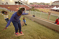 NWA Democrat-Gazette/BEN GOFF @NWABENGOFF<br /> Ell Burton, 11, of Manhattan, Kans. slides on Saturday Nov. 12, 2016 on the grassy hill on the North end of Razorback Stadium in Fayetteville before the Arkansas football game against LSU.