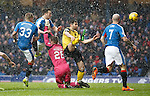 Danny WIlson heads in the opening goal for Rangers\