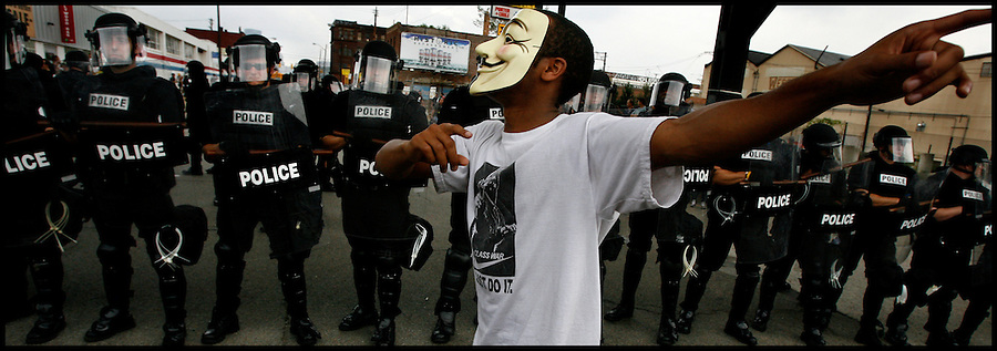 "Sept. 24,  - Pittsburgh, Pennsylvania, USA - .Riot police advance on protester Stephon Boatwright, a self-proclaimed ""Democratic-Socialist"" , near the site of the G-20 Summit in downtown Pittsburgh, PA Thursday. (Credit Image: Brian Blanco/ZUMA Press"