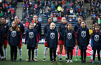 Seattle, WA - Saturday March 24, 2018: Washington Spirit, escort kids during a regular season National Women's Soccer League (NWSL) match between the Seattle Reign FC and the Washington Spirit at the UW Medicine Pitch at Memorial Stadium.