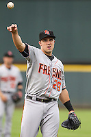 Fresno Grizzlies first baseman Adam Duvall (29) warms up before the Pacific Coast League baseball game against the Round Rock Express on June 22, 2014 at the Dell Diamond in Round Rock, Texas. The Express defeated the Grizzlies 2-1. (Andrew Woolley/Four Seam Images)