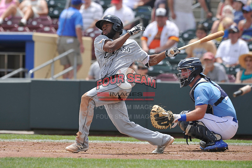 El Paso Chihuahuas center fielder Manuel Margot (4) swings during the game against the Omaha Storm Chasers at Werner Park on May 30, 2016 in Omaha, Nebraska.  El Paso won 12-0.  (Dennis Hubbard/Four Seam Images)