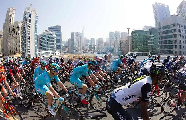 The peloton pass Dubai Marina for the start of Stage 2, the Nakheel Stage, of the 2016 Dubai Tour starting at the Dubai International Marine Club and running 188km to Palm Jumeirah Atlantis, Dubai, United Arab Emirates. 4th February 2016.<br /> Picture: ANSA/Claudio Peri | Newsfile<br /> <br /> <br /> All photos usage must carry mandatory copyright credit (&copy; Newsfile | Eoin Clarke)