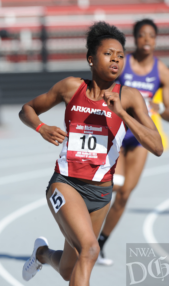 NWA Democrat-Gazette/ANDY SHUPE<br />Arkansas' Monisa Dobbins takes off Saturday, April 23, 2016, while competing in the 400 meters during the John McDonnell Invitational at John McDonnell Field in Fayetteville. Visit nwadg.com/photos to see more photographs from the game.