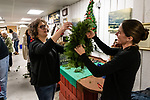 BETHLEHEM, CT. 06 December 2018-120618 - Wreath organizer and artistic mentor of wreath making Molly Worden of Northfield, right holds up Anna Carfield's wreath for her to inspect during the annual Wreath making social event at March Farms in Bethlehem on Thursday. Sue March the owner of March Farms says for everyone to sig up and get your spots early next year as they went very quickly this year. Bill Shettle Republican-American