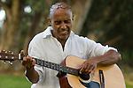 Man soulfully playing guitar