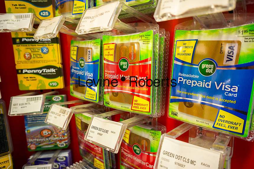 Green Dot brand debit cards in a store in New York on Tuesday, October 11, 2016. The Consumer Financial Protection Board has issued new rules for the prepaid debit card industry giving users many of the same protections once available only to credit card users. (© Richard B. Levine)