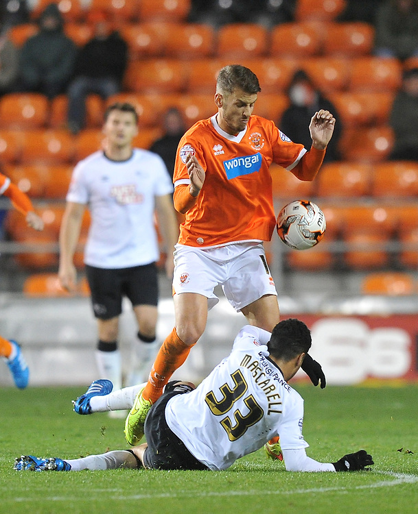 Blackpool's Andrea Orlandi and Derby County's Omar Mascarell battle for the ball<br /> <br /> Photographer Dave Howarth/CameraSport<br /> <br /> Football - The Football League Sky Bet Championship - Blackpool v Derby County - Tuesday 21st October 2014 - Bloomfield Road - Blackpool<br /> <br /> &copy; CameraSport - 43 Linden Ave. Countesthorpe. Leicester. England. LE8 5PG - Tel: +44 (0) 116 277 4147 - admin@camerasport.com - www.camerasport.com