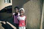 Two young children pictured at the farm stockade where they live in Pine Valley, Swaziland. The Kingdom of Swaziland (population 1.1m), a small, landlocked country in southern Africa was bordered by South Africa on three sides and Mozambique to the east, with Mbabane as its administrative capital. At the start of the 21st century, the country had the highest incidence per head of population of HIV/Aids in the world and and high levels of poverty mainly in rural areas where 75 per cent of the population lived.