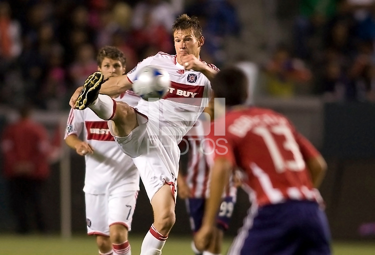 Chicago Fire forward Brian McBride passes a ball in front of Chivas USA defender Jonathan Bornstein. The Chicago Fire defeated Chivas USA 3-2 in extra time at Home Depot Center stadium in Carson, California on Thursday evening May 21, 2009.   .