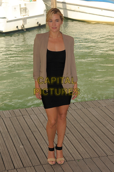 Kate Winslet.Attending the 'Carnage' photocall at the Palazzo del Casino during the 68th Venice Film Festival, Venice, Italy, September 1st 2011..full length  black jacket blazer beige dress  ankle strap open toe shoes sandals .CAP/PL.©Phil Loftus/Capital Pictures.