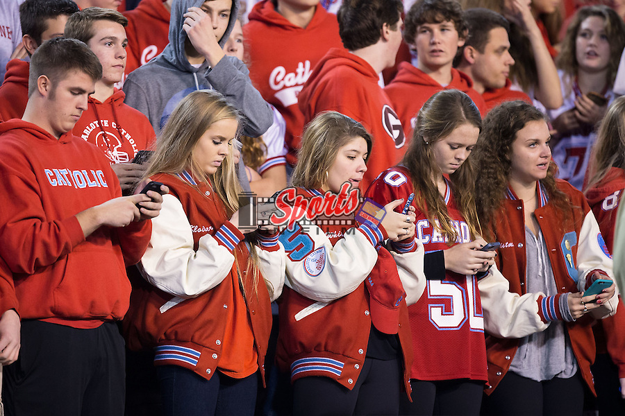 Charlotte Catholic Cougars students feverishly update their social media accounts following their schools victory over the J.H. Rose Rampants in the NCHSAA 4A State Championship at BB&T Field on December 12, 2015 in Winston-Salem, North Carolina.  The Cougars defeated the Rampants 27-20.  (Brian Westerholt/Sports On Film)