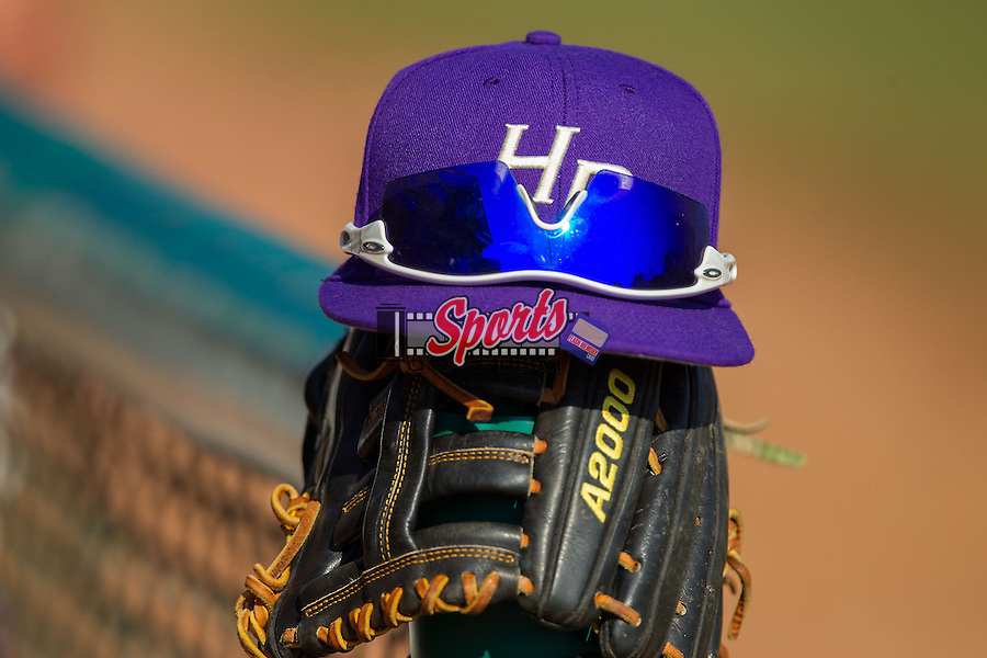 A High Point Panthers cap sits on top of a glove between innings of the game against the Bowling Green Falcons at Willard Stadium on March 9, 2014 in High Point, North Carolina.  The Falcons defeated the Panthers 7-4.  (Brian Westerholt/Sports On Film)