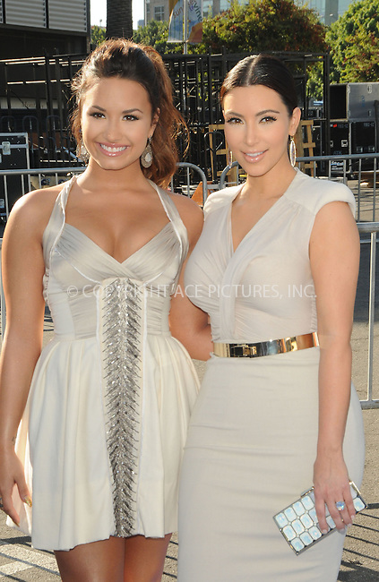WWW.ACEPIXS.COM . . . . . ....August 14, 2011, LA... Demi Lovato and Kim Kardashian arrive at the 2011 VH1 Do Something Awards at the Hollywood Palladium on August 14, 2011 in Hollywood, California......Please byline: PETER WEST - ACE PICTURES.... *** ***..Ace Pictures, Inc: ..Philip Vaughan (212) 243-8787 or (646) 679 0430..e-mail: info@acepixs.com..web: http://www.acepixs.com.