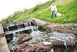 Cllr Frank Gallagher with Miley the Golden Retriever show the rubbish in the waterway in the Glen, Newfoundwell Road....Photo NEWSFILE/Jenny Matthews.(Photo credit should read Jenny Matthews/NEWSFILE)....This Picture has been sent you under the condtions enclosed by:.Newsfile Ltd..The Studio,.Millmount Abbey,.Drogheda,.Co Meath..Ireland..Tel: +353(0)41-9871240.Fax: +353(0)41-9871260.GSM: +353(0)86-2500958.email: pictures@newsfile.ie.www.newsfile.ie.FTP: 193.120.102.198.