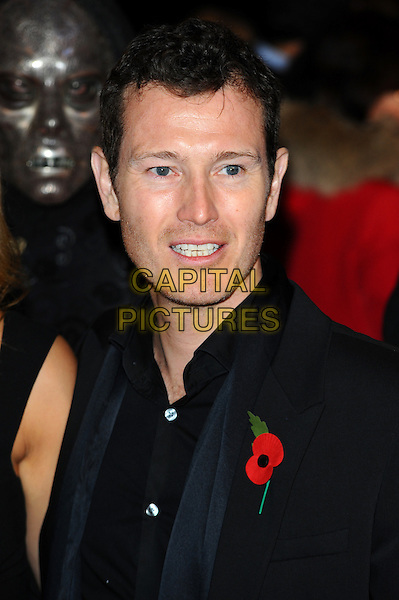 NICK MORAN .'Harry Potter And The Deathly Hallows: Part 1' world film premiere, Empire cinema Leicester Square and Odeon Leicester Square, London, England 11th November 2010.headshot portrait black stubble facial hair poppy.CAP/CJ.©Chris Joseph/Capital Pictures.