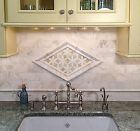 "This custom kitchen features a Fiona jewel glass backsplash in Quartz and Amber, a Cloud Nine polished pencil molding and chair rail, 3""x6"" Cloud Nine bricks and 3 1/2"" Julius border shown in honed Cloud Nine and polished Paperwhite. Fiona is part of the Silk Road® collection by New Ravenna.<br />