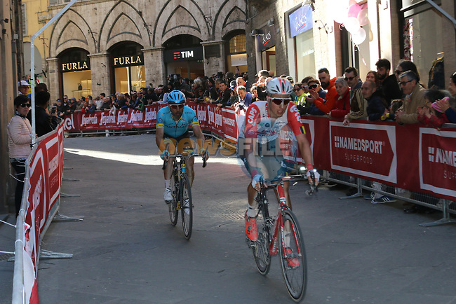 Riders round the final corner to finish in Siena Strade Bianche 2019 running 184km from Siena to Siena, held over the white gravel roads of Tuscany, Italy. 9th March 2019.<br /> Picture: Seamus Yore | Cyclefile<br /> <br /> <br /> All photos usage must carry mandatory copyright credit (© Cyclefile | Seamus Yore)