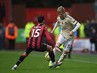 2nd November 2019; Vitality Stadium, Bournemouth, Dorset, England; English Premier League Football, Bournemouth Athletic versus Manchester United; Brandon Williams of Manchester United tries to go round Adam Smith of Bournemouth - Strictly Editorial Use Only. No use with unauthorized audio, video, data, fixture lists, club/league logos or 'live' services. Online in-match use limited to 120 images, no video emulation. No use in betting, games or single club/league/player publications