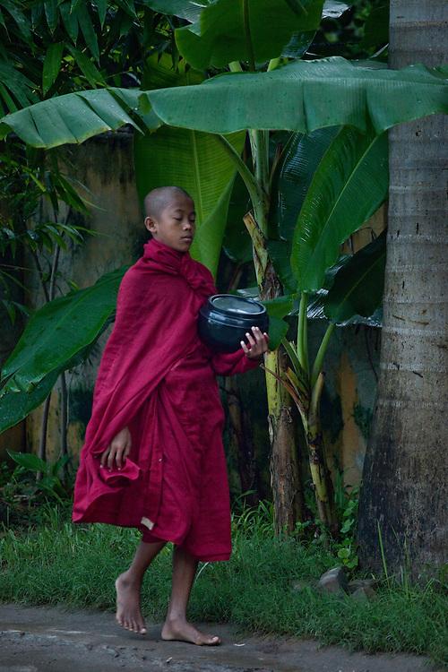 Monk walking on residential street in Mandalay,Burma