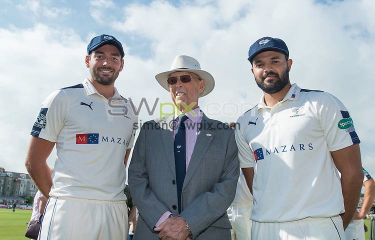 Picture by Allan McKenzie/SWpix.com - 23/08/2016 - Cricket - Specsavers County Championship - Yorkshire County Cricket Club v Nottinghamshire County Cricket Club - North Marine Road, Scarborough, England - Jack Leaning & Azeem Rafiq are presented with their county caps by Yorkshire President John Hampshire.