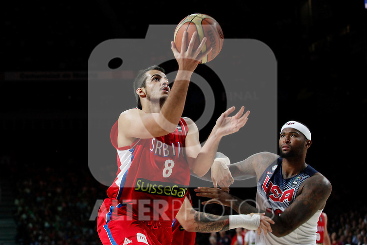United States´s Cousins (R) and Serbia´s Bjelica during FIBA Basketball World Cup Spain 2014 final match between United States and Serbia at `Palacio de los deportes´ stadium in Madrid, Spain. September 14, 2014. (ALTERPHOTOSVictor Blanco)