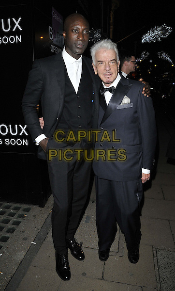 LONDON, ENGLAND - NOVEMBER 27: Ozwald Boateng &amp; Nicky Haslam attend the &quot;Mikhail Baryshnikov: Dancing Away&quot; photography collection private view, Contini Art UK, New Bond St., on Thursday November 27, 2014 in London, England, UK. <br /> CAP/CAN<br /> &copy;Can Nguyen/Capital Pictures