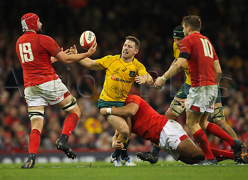 11th November 2017, Principality Stadium, Cardiff, Wales; Autumn International Series, Wales versus Australia; Bernard Foley of Australia is tackled by Leon Brown of Wales and loses the ball