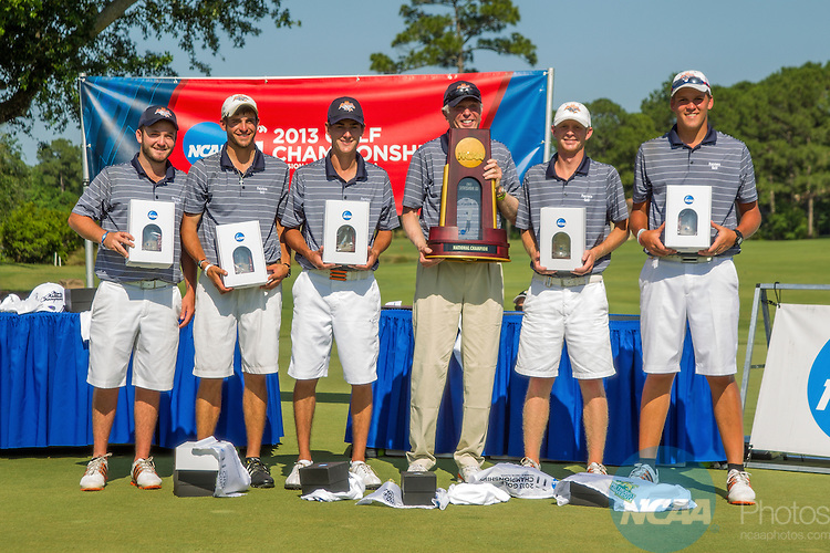17 MAY 2013:  The University of Texas at Tyler with their 1st place trophy on 18th green after the Patriots won the Division III Men's Golf Championship held at the Sandestin Golf and Beach Resort Raven Course in Destin, FL.  Mark Wallheiser/NCAA Photos