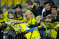 Phoenix fans wait for autographs after the A-League football match between Wellington Phoenix and Perth Glory at Westpac Stadium in Wellington, New Zealand on Sunday, 27 October 2019. Photo: Dave Lintott / lintottphoto.co.nz
