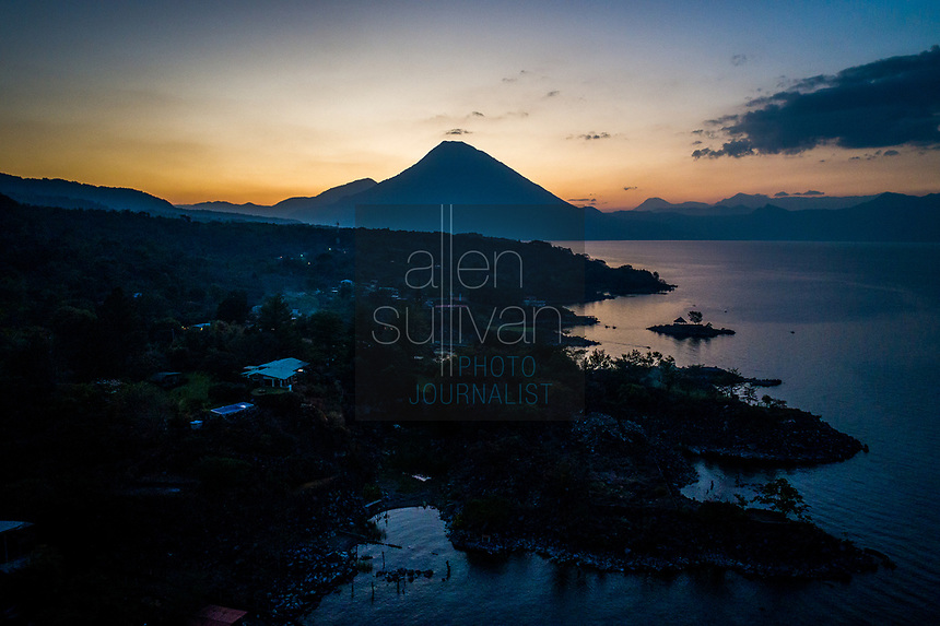 Volcán San Pedro is seen in a drone image from Cerro de Oro, Guatemala on Lago de Atitlán on February 8, 2018 at sunset.