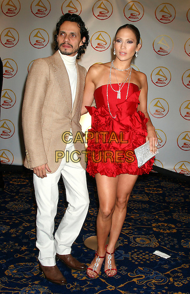 MARC ANTHONY & JENNIFER LOPEZ.The 2006 Latin Recording Academy Person Of The Year Tribute honoring Ricky Martin at Sheraton Hotels & Towers, New York, USA..November 1st, 2006.Ref: IW.full length married husband wife white trousers beige suit jacket red strapless dress gathered ruffles silver clutch purse.www.capitalpictures.com.sales@capitalpictures.com.©Ian Wilson/Capital Pictures