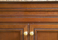 Detail of wooden kitchen cabinets.