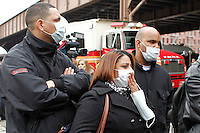 People arrive to the scene where a powerful explosion knocked two residential buildings in East Harlem killing 2 people and injuring at least 22 others in New York. March 12, 2014. Photo by Eduardo Munoz Alvarez/VIEW