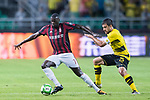 AC Milan Forward M'Baye Niang (L) fights for the ball with Borussia Dortmund Defender Sokratis Papastathopoulos (R) during the International Champions Cup 2017 match between AC Milan vs Borussia Dortmund at University Town Sports Centre Stadium on July 18, 2017 in Guangzhou, China. Photo by Marcio Rodrigo Machado / Power Sport Images