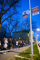 UNGARN, 08.04.2018, Budapest XI. Bezirk. Wahlabend der Parlamentswahl: An manchen Orten standen die Menschen noch Stunden nach der offiziellen Schliessung der Wahllokale Schlange, um ihre Stimme abzugeben, hier in der Bocskai &uacute;t. Vorne ein Plakat von Fidesz: &quot;Fuer uns kommt Ungarn an erster Stelle!&quot; | Parliamentary election night: At some places people still queued up for hours after the official end of the election session in order to be able to cast their vote, here in Bocskai street. In front a Fidesz election poster: &quot;For us Hungary comes first!&quot;<br /> &copy; Martin Fejer/estost.net