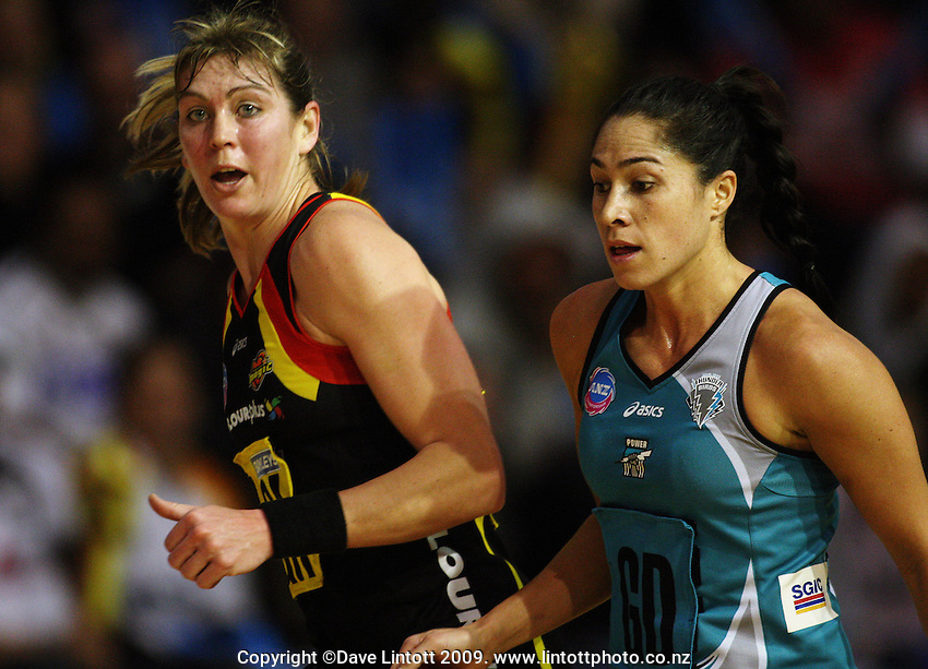 Magic goal attack Irene Van Dyk is marked by Mo'onia Gerrard during the ANZ Netball Championship match between the Waikato Bay of Plenty Magic and Adelaide Thunderbirds, Mystery Creek Events Centre, Hamilton, New Zealand on Sunday 19 July 2009. Photo: Dave Lintott / lintottphoto.co.nz