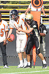 Palos Verdes, CA 09/22/11 - unknown Beverly Hills player(s) and Max MacLeay (Peninsula #5)) in action during the Beverly Hills-Peninsula Varsitty Football gane.