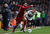 17th March 2019, Craven Cottage, London, England; EPL Premier League football, Fulham versus Liverpool; Mohamed Salah of Liverpool takes on Joe Bryan of Fulham