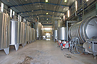 The vat hall with big stainless steel tanks for fermentation and the wine press to the right. Vinedos y Bodega Filgueira Winery, Cuchilla Verde, Canelones, Montevideo, Uruguay, South America