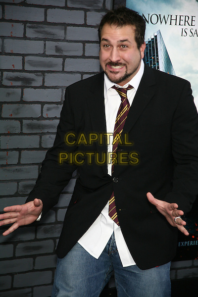 "JOEY FATONE.The New York Premiere of ""Harry Potter and the Deathly Hallows Part I"" held at Alice Tully Hall - Lincoln Center, New York, NY, USA..November 15th, 2010.half length black jacket white shirt beard facial hair hands funny.CAP/LNC/TOM.©TOM/LNC/Capital Pictures."